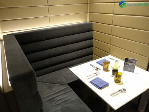 Highly private individual booth at the expanded United Polaris Lounge Chicago O'Hare