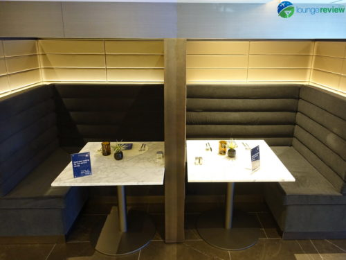 Private dining booths at the expanded United Polaris Lounge Chicago O'Hare