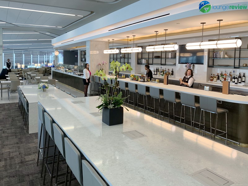 Communal work tables at the new United Club LaGuardia