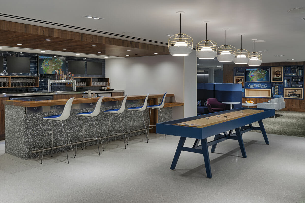Bar and game room at the Centurion Lounge by American Express Denver