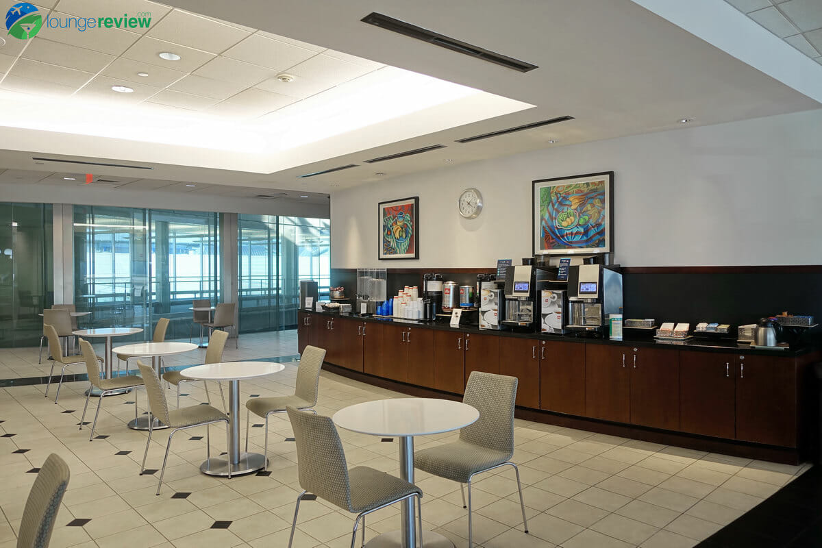 Coffee and beverage stand at the United Club Houston Terminal E